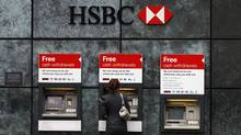 A woman uses a cash point machine at a HSBC bank in London in this February 28, 2011 file photo. (Andrew Winning/Reuters/Andrew Winning/Reuters)
