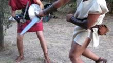 Bored no more: Ben Fotia, left, spars with gladiator school founder Giorgio Franchetti.