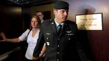 Captain Robert Semrau leaves his military tribunal with his wife Amelie Lapierre-Semrau in Gatineau, Quebec July 19, 2010. (CHRIS WATTIE/Chris Wattie/Reuters)