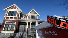 A real estate sold sign is shown outside a house in Vancouver, Tuesday, Jan. 3, 2017. (Jonathan Hayward/THE CANADIAN PRESS)