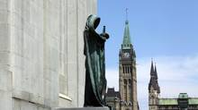 The statue of Ivstitia (Justice) is shown on the front steps of the Supreme Court of Canada building in Ottawa. (DAVE CHAN FOR THE GLOBE AND MAIL)