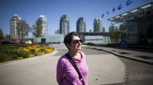 Fern Jeffries of the False Creek Residents Association is photographed on Concord Pacific's nine-acre parcel of land in Vancouver, which will remain a sales centre despite being zoned as park land. (Rafal Gerszak for The Globe and Mail)