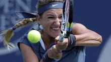 Victoria Azarenka, of Belarus, returns a serve from Ana Ivanovic, of Serbia, during their semifinal match at the Southern California Open tennis tournament, Saturday, Aug. 3, 2013, in Carlsbad, Calif. Azarenka has withdrawn from the Rogers Cup due to a back injury. (Gregory Bull/AP)