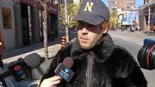 "World-renowned Cape Breton fiddler Ashley MacIsaac confronted PETA protesters in downtown Windsor, Ont., on Friday afternoon. MacIsaac arrived at an anti-fur demonstration alone, unannounced and wearing a muskrat fur coat. He was also carrying a handmade sign reading ""I support the Canadian Seal Hunt."" (CBC framegrab/CBC framegrab)"