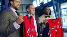 Toronto Raptors president and general manager Bryan Colangelo (centre) introduces new players Landry Fields (left), and Kyle Lowry at a news conference in Toronto, Tuesday, July 17, 2012. (Ian Willms/THE CANADIAN PRESS)