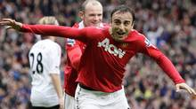 Manchester United's Dimitar Berbatov, right, celebrates with teammate Wayne Rooney after scoring his second goal against Liverpool during their English Premier League soccer match at Old Trafford Stadium, Manchester, England, Sunday Sept. 19, 2010. (Reuters)
