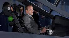 Defence Minister Peter MacKay checks out the cockpit of the F-35 Joint Strike Fighter after the Conservative government announced its intention to purchase 65 of the next-generation planes at an Ottawa news conference on July 16, 2010. (Adrian Wyld/The Canadian Press)