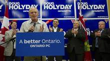 Doug Holyday speaks during the official opening of his by-election offices on July 8, 2013, with Bernard Trottier, Conservative MP for Etobicoke-Lakeshore, left; PC Leader Tim Hudak; Toronto Councillor Doug Ford; and Mayor Rob Ford. (DEBORAH BAIC/THE GLOBE AND MAIL)