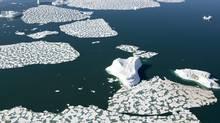 Ice patterns and icebergs are seen in Croaker Bay near Devon Island in Canada's Arctic, Friday, July 11, 2008. (JONATHAN HAYWARD/Jonathan Hayward/THE CANADIAN PRESS)