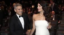 George and Amal Clooney have welcomed twins Ella and Alexander Clooney. (Thibault Camus/AP)