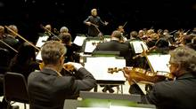 The Toronto Symphony Orchestra performs at Roy Thompson Hall in Toronto, conducted by music director Peter Oundjian. (Sian Richards)