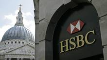 A sign of HSBC bank is seen, backropped by part of St. Paul's Cathedral, in central London. (SANG TAN/AP)
