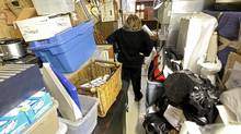 Linda is seen here in her basement where piles of belongings are stacked to the ceiling Tuesday Oct. 26, 2010. (Tim Fraser for The Globe and Mail/Tim Fraser for The Globe and Mail)