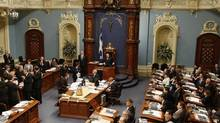 A crucifix is seen over the Speaker's chair at the National Assembly in Quebec City. (MATHIEU BELANGER/REUTERS)