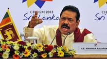 Sri Lankan President Mahinda Rajapaksa gestures as he answers during a media briefing on the final day of the Commonwealth Heads of Governments meeting in Colombo on Nov. 17, 2013. (ERANGA JAYAWAREDENA/ASSOCIATED PRESS)