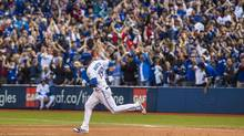 Toronto Blue Jays' Jose Bautista runs the bases on his three run home run against the New York Yankees during the eighth inning of MLB baseball action in Toronto, Saturday September 24, 2016 (Mark Blinch/THE CANADIAN PRESS)