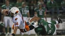 BC Lions quarterback Travis Lulay is tripod up by Saskatchewan Roughriders defensive tackle David Veikune during the first half of CFL action in Regina, Sask., Saturday, September 29, 2012. (Liam Richards/THE CANADIAN PRESS)