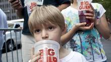 Benjamin Lesczynski, 8, of New York, takes part in a protest against the proposed soda ban in New York City, July 9, 2012. (ANDREW BURTON/REUTERS)