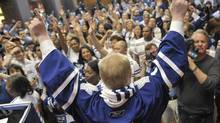 Toronto Mayor Rob Ford, surrounded by the city's hockey fans, declares Monday 'blue and white day' in honour of the Maple Leafs, during a noon rally at Scotiaplaza, in Toronto, May 6, 2013. (J.P. MOCZULSKI for the globe and mail)