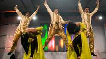 Dancers perform at the Vancouver announcement of The Times of India Film Awards. (DARRYL DYCK/THE CANADIAN PRESS)