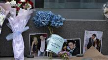 Flowers and photos are left at a small memorial for Canadian actor Cory Monteith outside a downtown hotel in Vancouver, July 15, 2013. Monteith, the 31-year-old heartthrob of the musical comedy television series Glee, was found dead in his hotel room on Saturday. (ANDY CLARK/REUTERS)