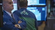 Traders work on the floor of the New York Stock Exchange, October 7, 2013. (BRENDAN MCDERMID/REUTERS)