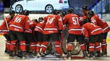Swiss players regroup during the IIHF Ice Hockey World Championship group B match between Switzerland and Belarus. (JOE KLAMAR/AFP/Getty Images)