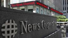 A sign is seen outside News Corporation building in New York, June 27, 2012. (BRENDAN MCDERMID/REUTERS)