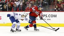 Washington Capitals left-wing Andre Burakovsky (65) shoots the puck as Toronto Maple Leafs defenceman Frank Corrado (20) defends in the second period at Verizon Center in Washington, D.C., on Wednesday, March 2, 2016. (Geoff Burke/USA Today Sports)
