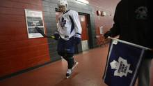 Maple Leafs defenceman John-Michael Liles walks past a fan after practice Monday at the MasterCard Centre for Hockey Excellence in Toronto. (Fred Lum/The Globe and Mail)