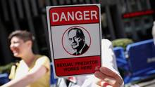 A demonstrator holds a sign at a protest calling for the firing of Fox News Channel TV anchor Bill O'Reilly outside the News Corporation headquarters in New York City, New York, U.S., April 18, 2017. (MIKE SEGAR/REUTERS)