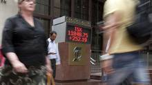 The sign outside Scotia Plaza in Toronto shows the closing numbers of the TSX last week. (Matthew Sherwood/The Globe and Mail)