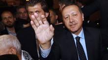 Turkish Prime Minister Recep Tayyip Erdogan waves upon his arrival on September 14, 2011 in Tunis. (FETHI BELAID/FETHI BELAID/AFP/Getty Images)