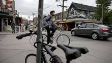 Scenes in Toronto's Kensington Market June 7, 2013. A proposal to develop a nearby property including a Walmart store has upset some city residents. (Moe Doiron/The Globe and Mail)