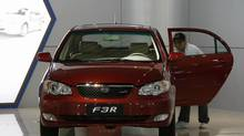 A worker cleans a BYD F3R car displayed inside the showroom at its headquarters in China's southern city of Shenzhen on Feb. 23, 2010. (© Bobby Yip / Reuters/REUTERS)