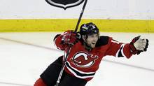 New Jersey Devils' Stephen Gionta celebrates after assisting on a goal by Steve Bernier during the third period of Game 4 of a first-round NHL hockey Stanley Cup playoff series against the Florida Panthers, Thursday, April 19, 2012, in Newark, N.J. The Devils won 4-0. (Julio Cortez/AP)