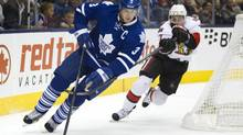 The Leafs captain Dion Phaneuf skates around the back of his net while being chased by Kyle Turris of the Senators during a pre-season game between the Toronto Maple Leafs and the Ottawa Senators at the ACC in Toronto on Sept. 24, 2013. (Peter Power/The Globe and Mail)