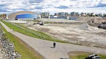 George Wong of Magnum Projects stands in front of the site of Phase One of the River Green condominium project, next to Richmond's Olympic Oval, on April 28, 2010. (Brett Beadle for The Globe and Mail)