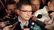 Alberta Premier Ed Stelmach takes questions during a scrum at the Alberta PC party's annual meeting in Red Deer. (Jeff McIntosh/Jeff McIntosh/The Canadian Press)