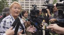 Quebec Premier Pauline Marois responds to questions about the proposed Charter of Values while walking to her office to in September. (Jacques Boissinot/THE CANADIAN PRESS)