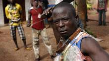 A member of the anti-balaka, a Christian militia, poses with his machete in village of Zawa April 8, 2014. REUTERS/Goran Tomasevic (CENTRAL AFRICAN REPUBLIC - Tags: CIVIL UNREST POLITICS) (GORAN TOMASEVIC/REUTERS)