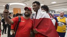 R.J Barrett has his photo taken with a well wisher after arriving at Toronto's Pearson Airport with other members of Canada's under-19 basketball team on July 10, 2017. (Chris Young/THE CANADIAN PRESS)