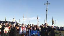 Members of the clergy join protesters against the Dakota Access oil pipeline in southern North Dakota near Cannon Ball on Thursday, Nov. 3, 2016, to draw attention to the concerns of the Standing Rock Sioux and push elected officials to call for a halt to construction. The tribe says the $3.8 billion, four-state pipeline threatens its drinking water and cultural sites. (James MacPherson/AP)