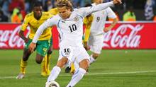 Diego Forlan of Uruguay shoots and scores a penalty during the 2010 FIFA World Cup South Africa Group A match between South Africa and Uruguay at Loftus Versfeld Stadium. (Cameron Spencer/2010 Getty Images)