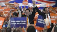 NDP Leader Adrian Dix, centre, attends a rally in downtown Vancouver during the first day of the B.C. election campaign on Tuesday, April 16, 2013. (JONATHAN HAYWARD/THE CANADIAN PRESS)
