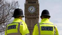 British police officers stand near Elizabeth Tower (commonly known as Big Ben) at the Houses of Parliament in London on March 30, 2017. U.K. police questioned six people Sunday in a vicious attack on a teenage asylum-seeker in the London borough of Croydon. (JUSTIN TALLIS/AFP/Getty Images)