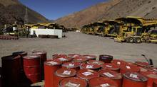 Mining machinery and barrels with chemicals sit on the facilities of Barrick Gold Corp's Pascua-Lama project in northern Chile, Thursday, May 23, 2013. (Jorge Saenz/AP Photo)