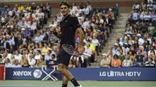 Roger Federer of Switzerland reacts during his fourth-round men's singles match against Roberto Bautista Agut of Spain in Arthur Ashe Stadium at the U.S. Open tennis tournament in New York, Sept. 2, 2014. (BARTON SILVERMAN/NYT)