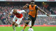 Arsenal's English midfielder Theo Walcott, left, chases Hull City's defender Moses Odubajo during the FA cup fifth round football match between Arsenal and Hull City at the Emirates Stadium in London on February 20, 2016. (GLYN KIRK/AFP/Getty Images)