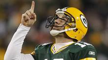 Green Bay Packers' Aaron Rodgers reacts to a touchdown pass during the second half of an NFL football game against the Chicago Bears Sunday, Dec. 25, 2011, in Green Bay, Wis. (AP Photo/Jeffrey Phelps) (Jeffrey Phelps)